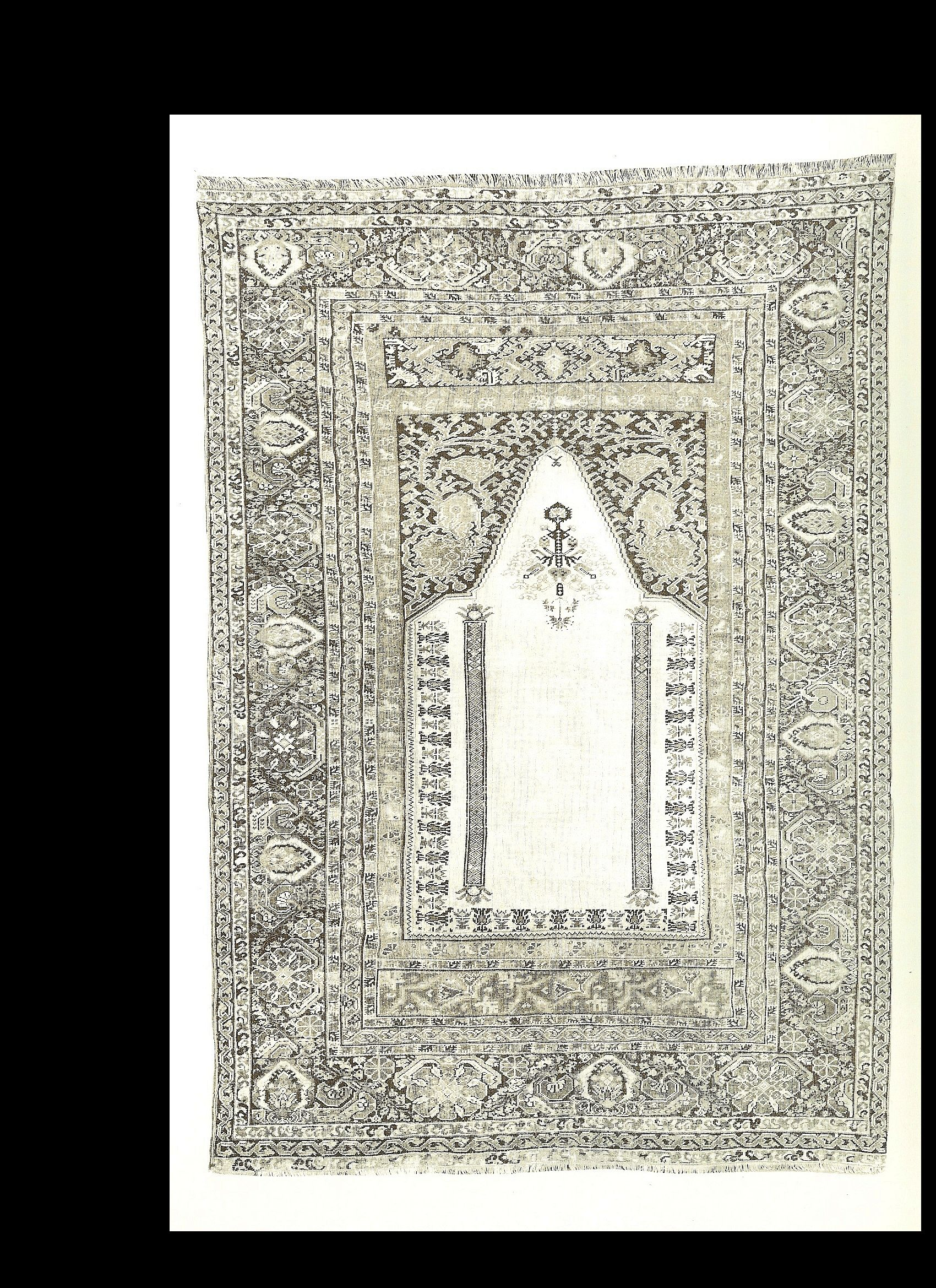 AR6c. Basra Prayer Rug in book