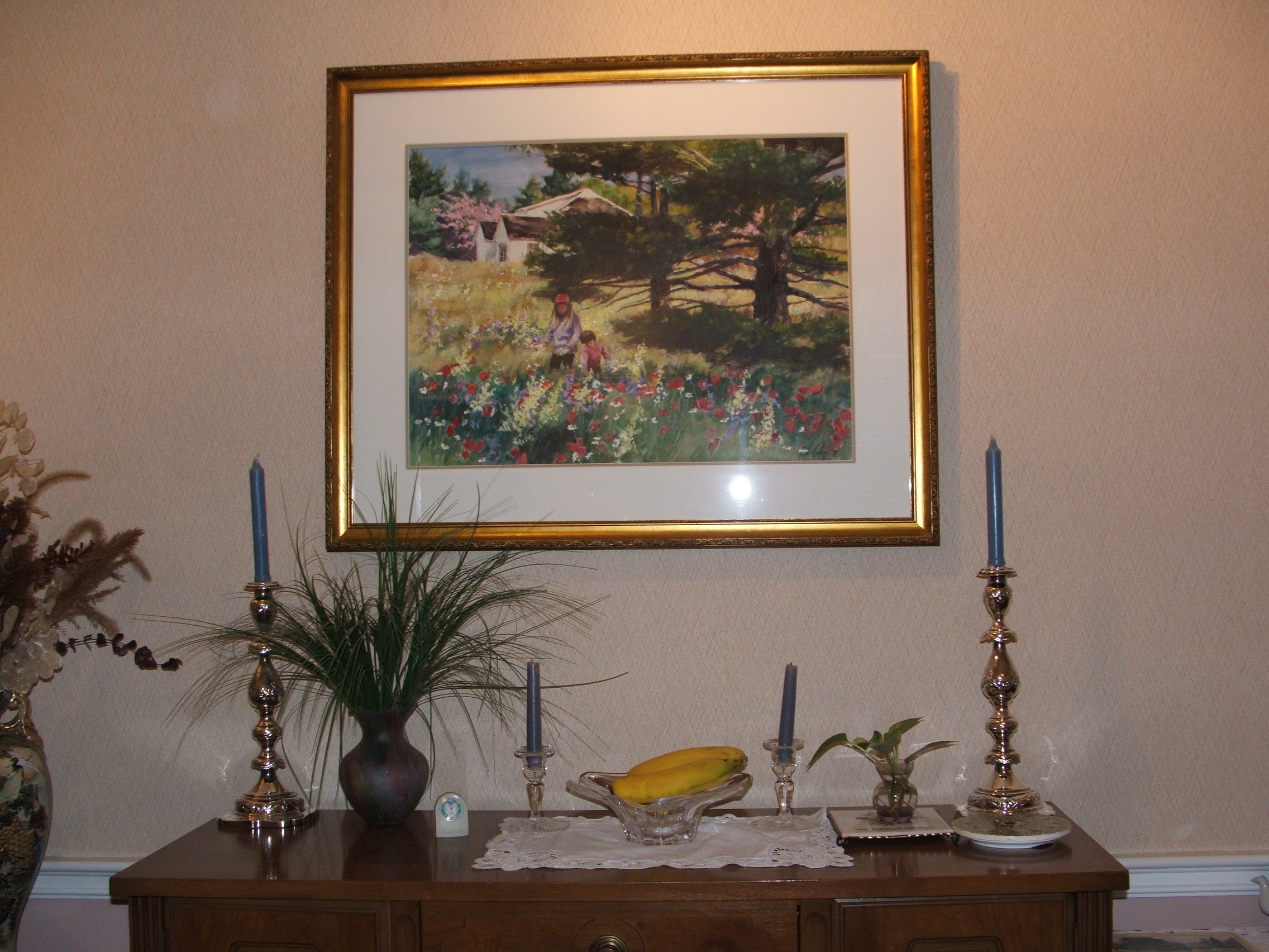 Large painting with w. elegant silver Candlesticks